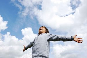 Child, freedom, breathing fresh air in nature