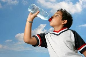 boy drinking from water bottle